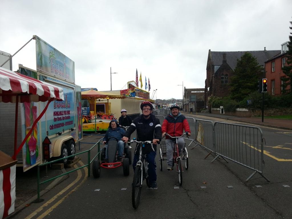 adaptive cycles making their way through the fair.